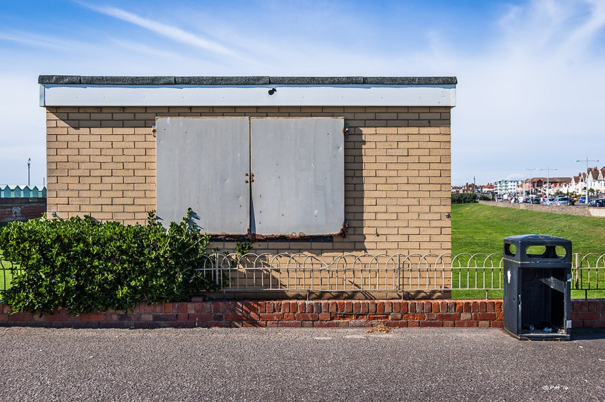Seafron Kiosk with metal shutters closed next to rubbish bin with no door, Hove UK. Colour Landscape. © P.Maton 2014 eyeteeth.net