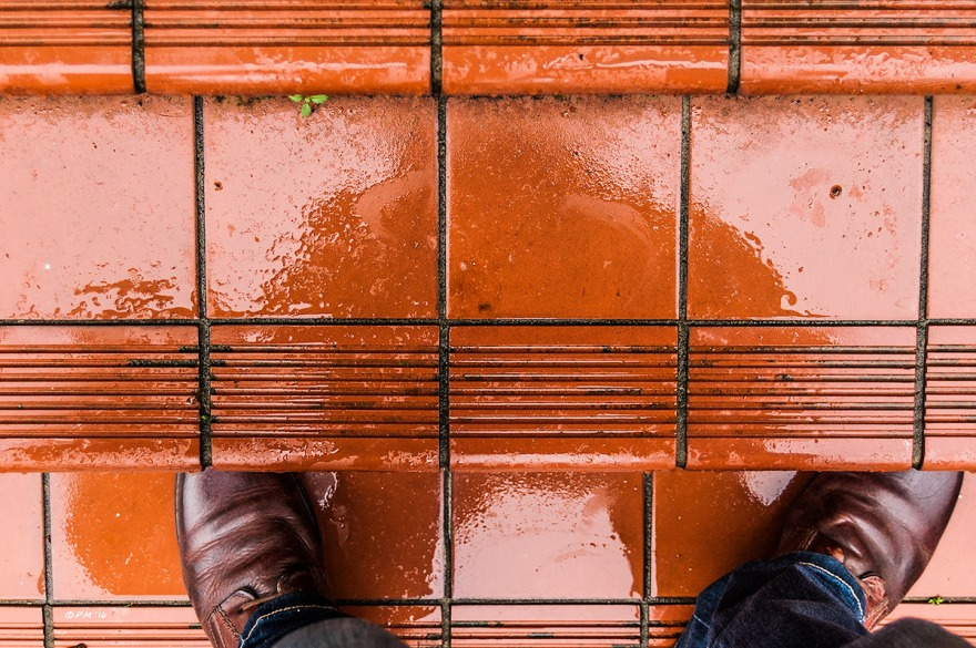 Abstract Self reflected in rain soaked red tiled steps with boots visible, Brighton Street Photography UK. Colour Landscape. © P.Maton 2014 eyeteeth.net