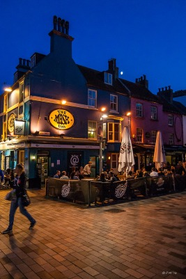 Colourful Night time view of people outside Mash Tun Pub New Road Brighton UK. Colour Portrait. © P.Maton 2014 eyeteeth.net