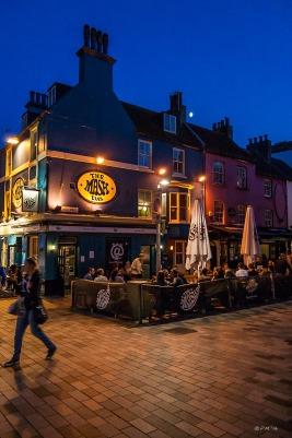 Colourful Night time view of people outside Mash Tun Pub New Road Brighton UK. Colour Portrait. © P.Maton 2014 eyeteeth.net