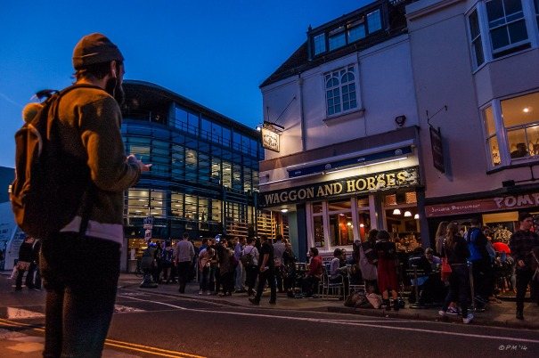 Colourful Night time view of people outside The Wagon and Horses Pub Church Road Brighton UK. Colour Landscape. © P.Maton 2014 eyeteeth.net