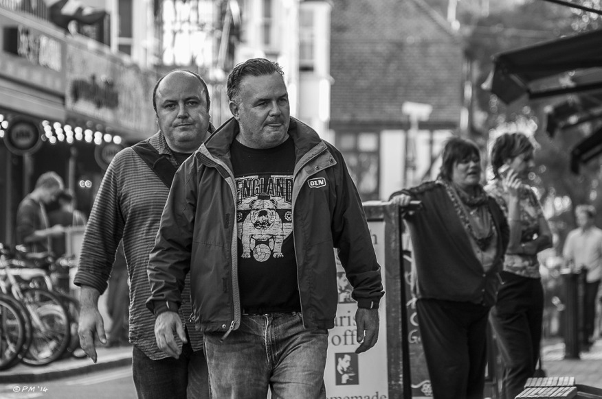 Two brothers walking in street. Gardener Street, Brighton, UK © P.Maton 2014 eyeteeth.net