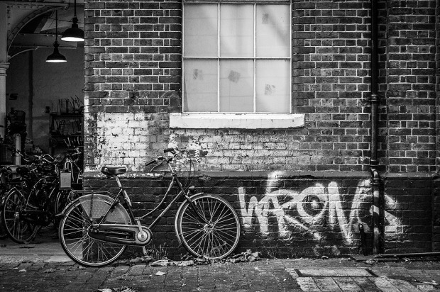 Ladies Bicycle propped against old building with Graffiti, Amsterdam's Bikes Trafalgar Arches Brighton UK. Monochrome Landscape. © P. Maton 2014 eyeteeth.net