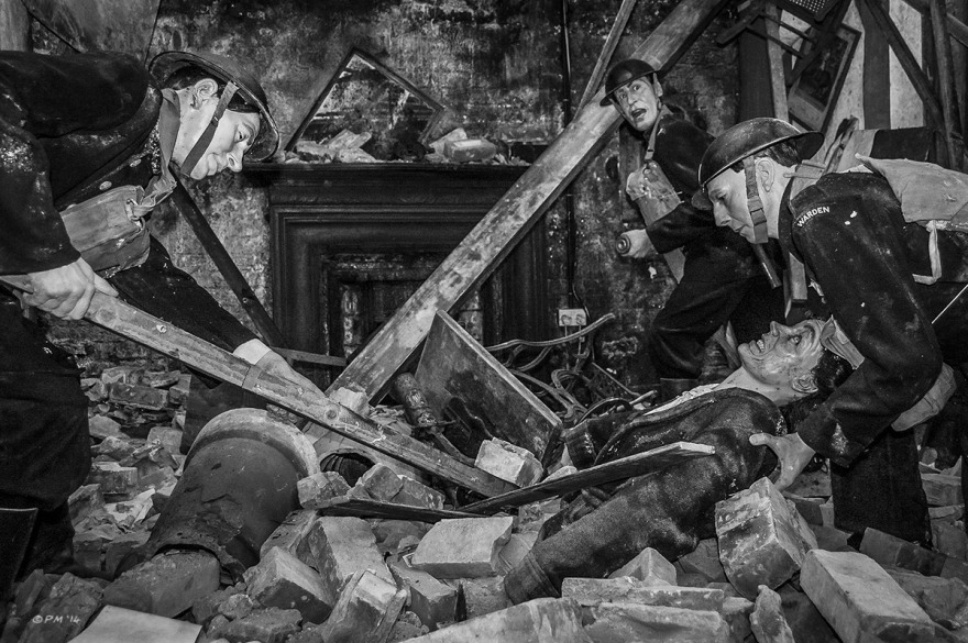 Air Raid Precautions Wardens digging woman out from rubble in bombed home, Home From Exhibition at Newhaven Fort, Newhaven East Sussex UK. Monochrome Landscape. © P. Maton 2014 eyeteeth.net