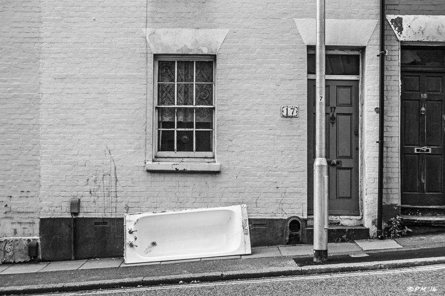 Old Bath tub on street outside terraced houses on Terminus Road Brighton UK. Monochrome landscape. © P. Maton 2014 eyeteeth.net