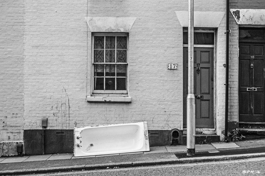 Old Bath tub on street outside terraced houses on Terminus Road Brighton UK. Monochrome landscape. © P. Maton 2014 eyeteeth.net