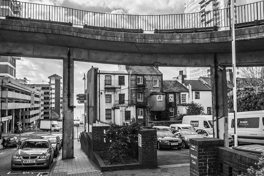 View along Cannon Place to the sea with overpass, back of hoses on Russell Square, Multi-story car park and sussex heights. Brighton UK. Monochrome Landscape. © P. Maton 2014 eyeteeth.net