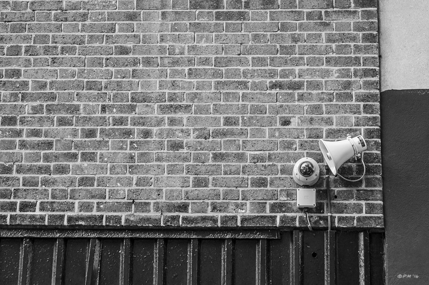 Security camera and loudspeaker on brick wall. Abstract Monochrome landscape. © P. Maton 2014 eyeteeth.net