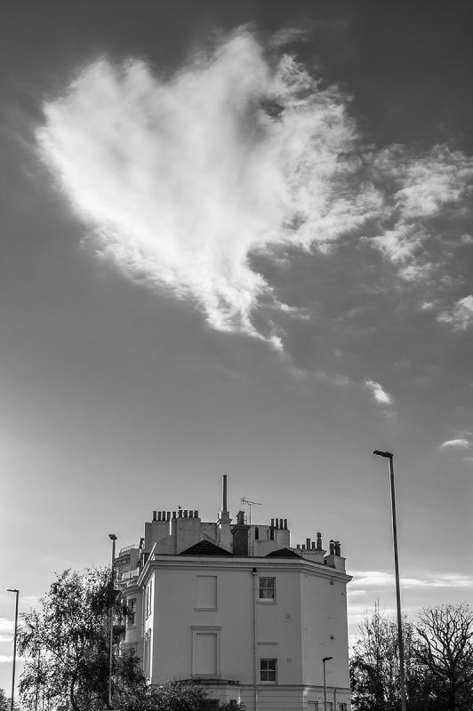 Heart Shaped Cloud dispersing in sky over Regency style house, Seven Dials Brighton UK. Monochrome Portrait. © P. Maton 2014 eyeteeth.net
