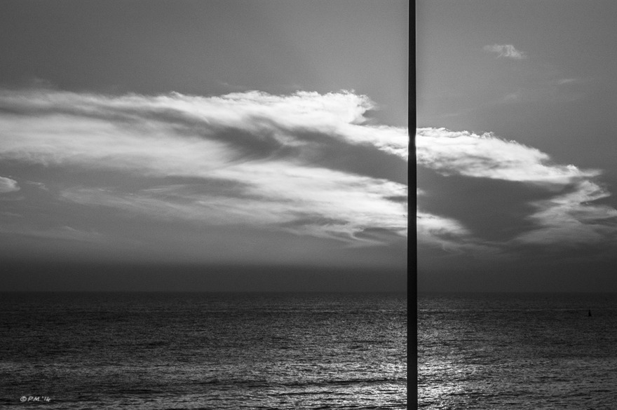 Flag pole silhouetted against sunlit cloud over sea, golden ratio section. Brighton UK. Monochrome Landscape. © P. Maton 2014 eyeteeth.net