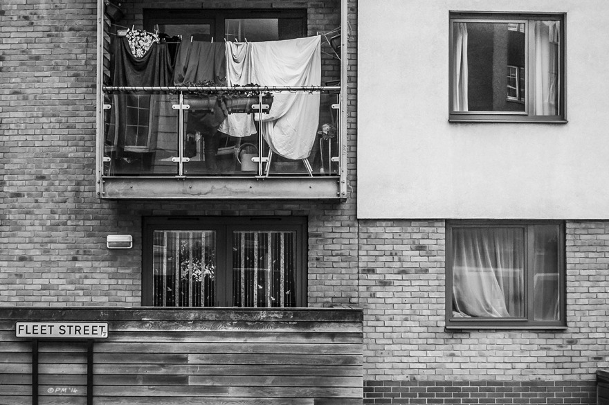 Apartment windows and balcony with washing hanging out to dry on Fleet Street Brighton UK. Monochrome Landscape. © P. Maton 2014 eyeteeth.net