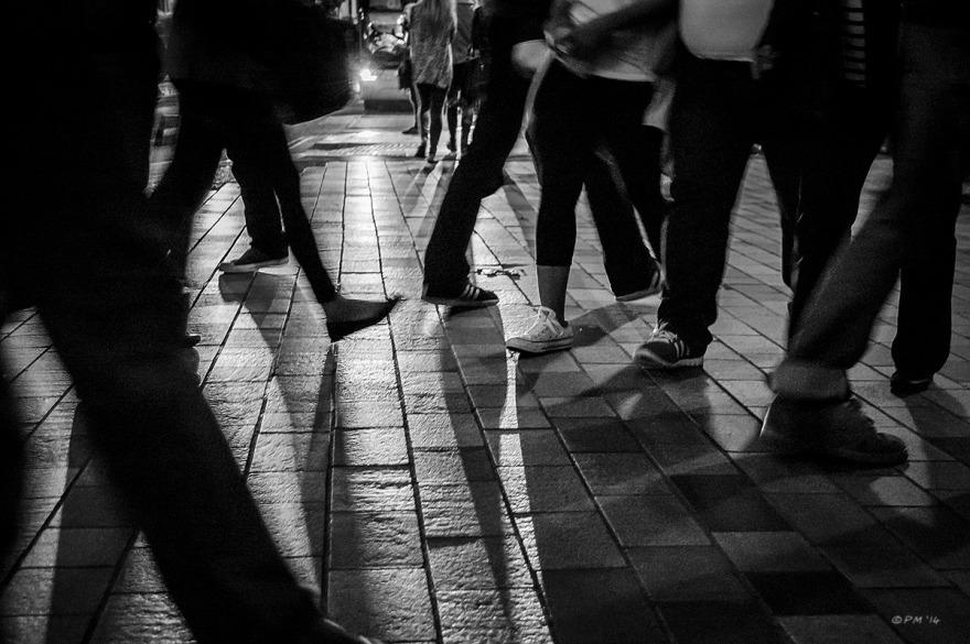 Legs of people walking in front of car headlamps. Abstract Monochrome Landscape. © P. Maton 2014 eyeteeth,net