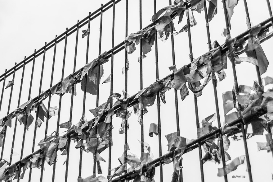 Remains of sticky tape from fly posters attached to wire mesh fence Trafalgar Street Brighton UK. Abstract Monochrome Landscape. © P. Maton 2014 eyeteeth.net