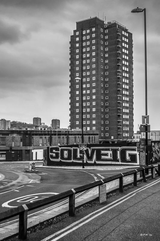 Theobald House tower block seen from corner of Fleet Street with Graffiti in foreground. Brighton UK. Monochrome Portrait. © P. Maton 2014 eyeteeth.net