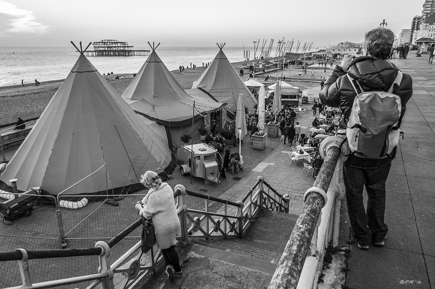 People by steps taking photos of tipis outside Gemini Beach Bar Brighton UK. Monochrome Landscape. © P. Maton 2014 eyeteeth.net