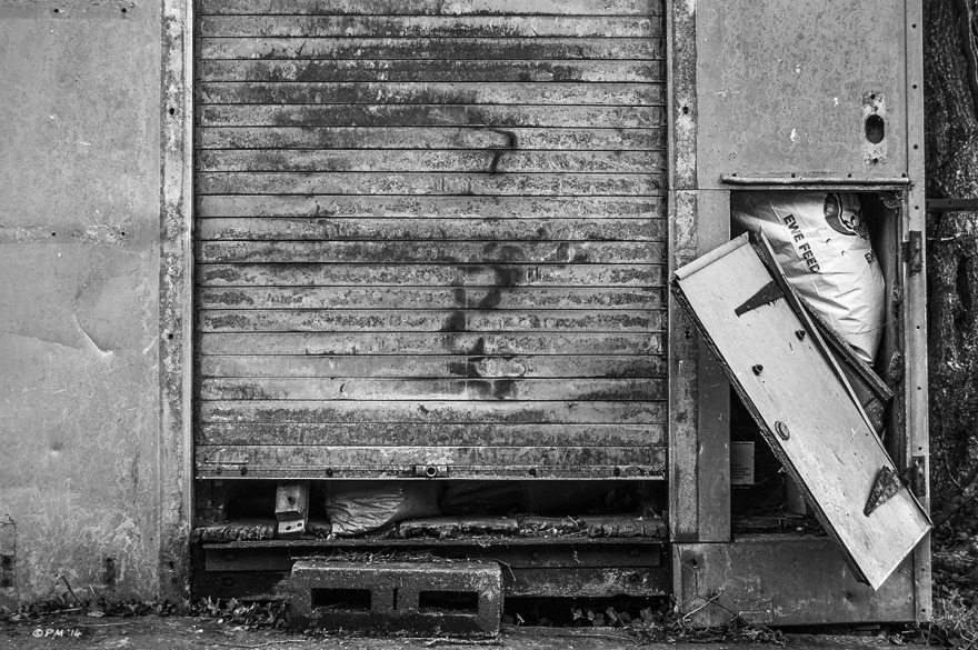 Broken door on animal feed shed. Mohair Centre Sussex UK. Monochrome Landscape. © P. Maton 2014 eyeteeth.net