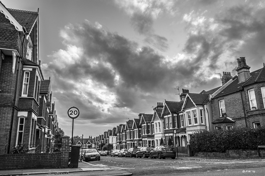 View south down Cissbury Road with parked cars and clouds overhead, Brighton UK. Monochrome landscape. © P. Maton 2014 eyeteeth.net