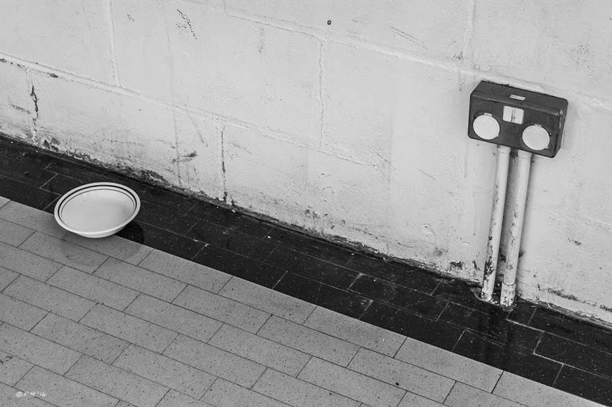 Abstract, Gym hall plug sockets next to china bowl on floor. Land port Boys Club, Lewes East Sussex. Monochrome Landscape. © P. Maton 2014 eyeteeth.net