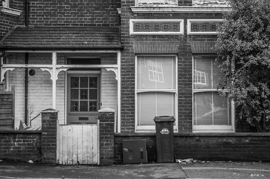 Victorian house with sash windows and wooden porch with dustbin and recycling container on pavement, Old Shoreham Road, Brighton UK. Monochrome Landscape. © P. Maton 2014 eyeteeth.net