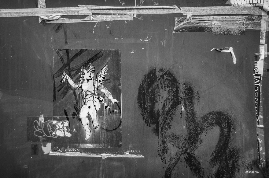 Cherub stencil graffiti on side of re-cycling bin, Vernon Terrace Brighton UK. Monochrome Landscape. © P. Maton 2014 eyeteeth.net