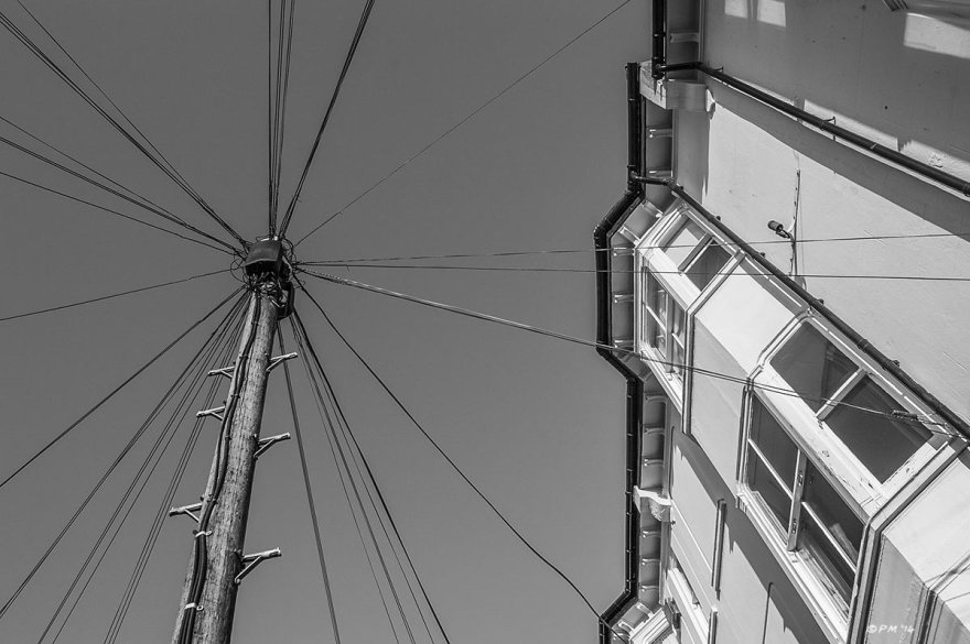 Telegraph pole with wires radiating in all directions next to Regency terraced houses on Cliffton Street Brighton UK. Monochrome Landscape. © P. Maton 2014 eyeteeth.net