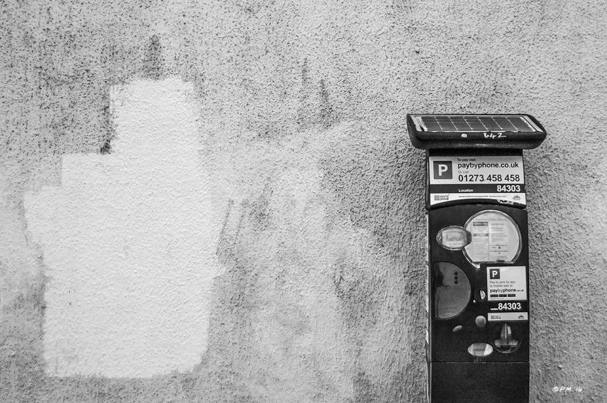 Parking ticket machine by dirty white rendered wall with patch of fresh paint. Howard Terrace Brighton UK. Monochrome Landscape. © P. Maton 2014 eyeteeth.net