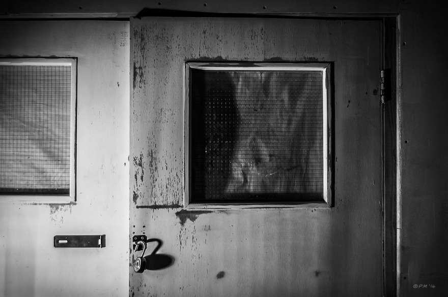 Unlocked internal door with blocked out reenforced glass windows, Coachwerks Brighton UK. Abstract Monochrome Landscape. © P. Maton 2014 eyeteeth.net