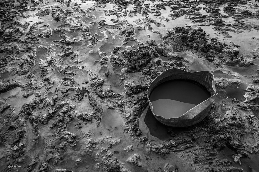 Plastic water container sitting on waterlogged mud in pig enclosure. Mohair Centre Sussex UK. Monochrome Landscape. © P. Maton 2014 eyeteeth.net