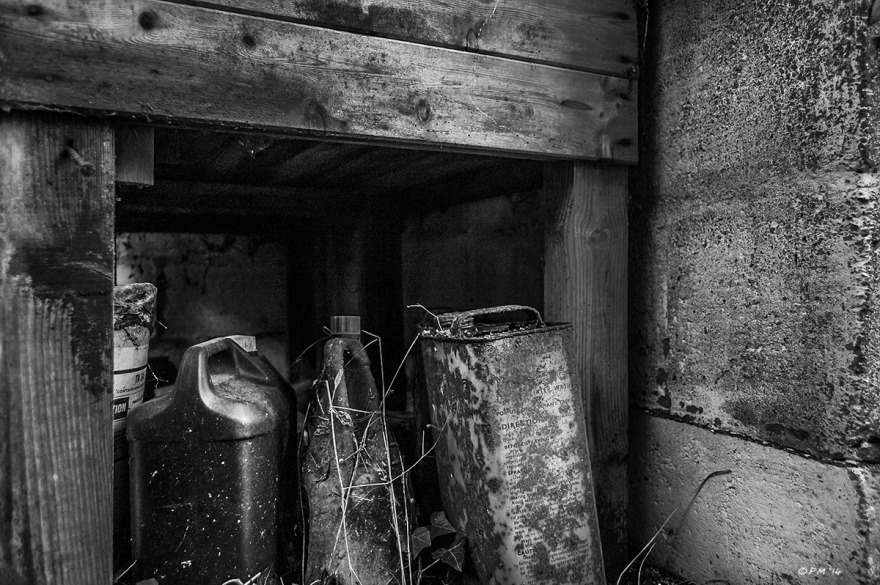 Rusty containers under work bench in abandoned stable. Ford Lane, Frilford Oxfordshire UK. Monochrome Landscape. © P. Maton 2014 eyeteeth.net