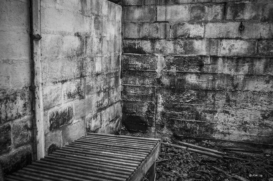 Slatted table by wall among detritus in abandoned stable. Ford Lane, Frilford Oxfordshire UK. Monochrome Landscape. © P. Maton 2014 eyeteeth.net