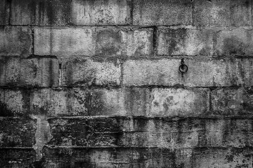 Iron ring hanging on decayed wall in abandoned stable. Ford Lane, Frilford Oxfordshire UK. Monochrome Landscape. © P. Maton 2014 eyeteeth.net