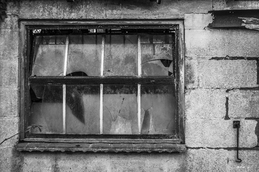 Abandoned stable, broken window in concrete block wall. Ford Lane, Frilford Oxfordshire UK. Monochrome Landscape. © P. Maton 2014 eyeteeth.net