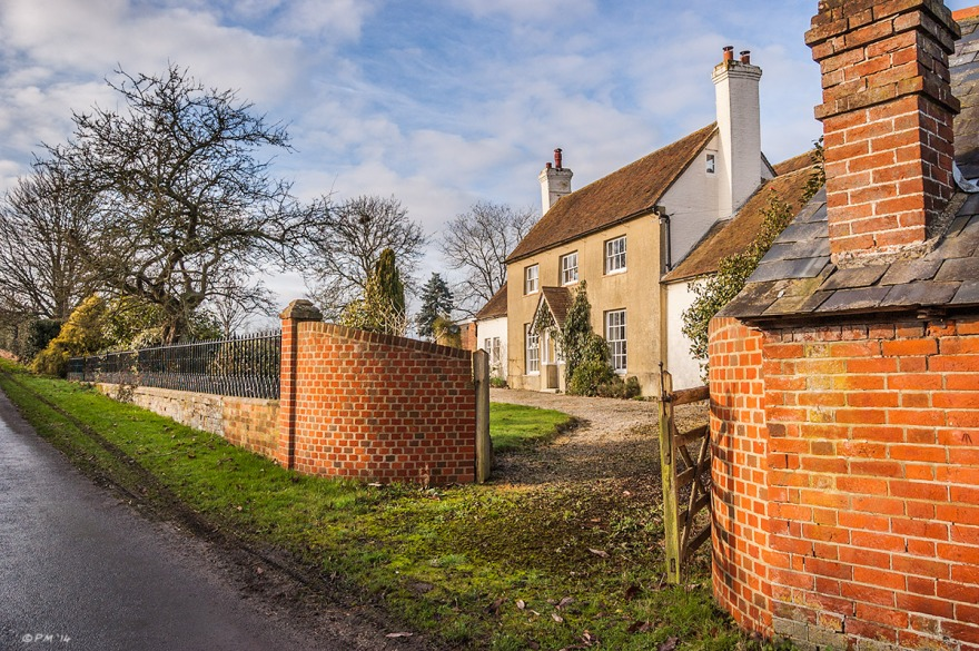 Sunlit stone farm house with gateway and red brick building in foreground. Brooks Lands Farm, Mortimer Berkshire UK. Colour Landscape. © P. Maton 2014 eyeteeth.net