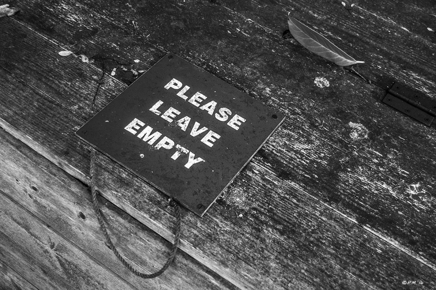 'please leave empty' sign on wooden compost container in graveyard with laurel leaf . Monochrome Landscape. © P. Maton 2014 eyeteeth.net