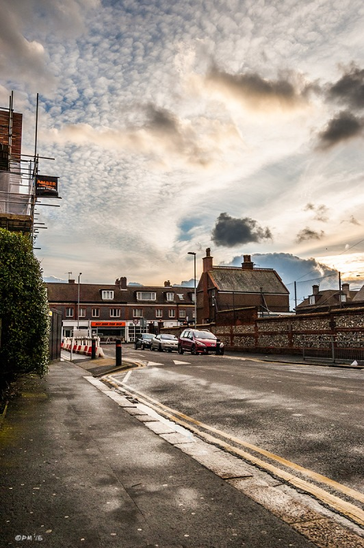 Dramatic evening clouds over urban street with wet road and parked cars. School Road Hove UK. Colour Portrait. © P. Maton 2015 eyeteeth.net