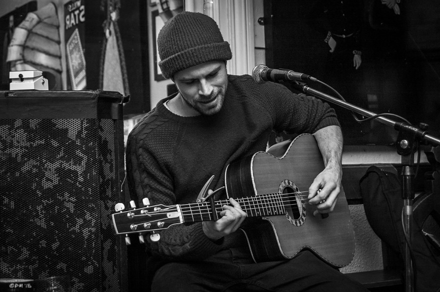 Luke Day Folk Singer at the Shakespeare's Head Pub Brighton UK. Monochrome Landscape. © P. Maton 2015 eyeteeth.net