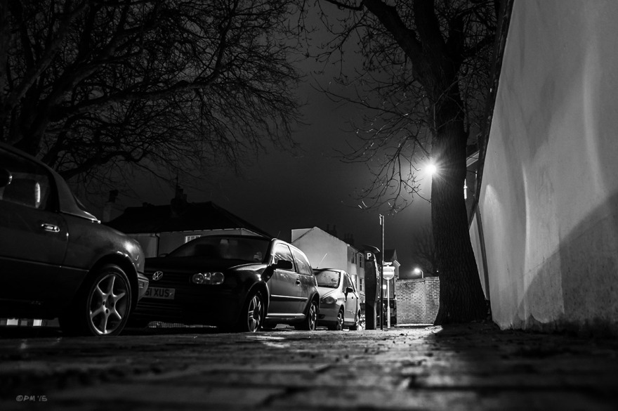 Street lamp and cars taken from pavement level at night. Monochrome Landscape. © P. Maton 2015 eyeteeth.net