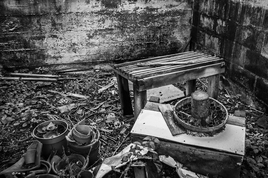 Table and plant pots among detritus in abandoned stable. Ford Lane, Frilford Oxfordshire UK. Monochrome Landscape. © P. Maton 2014 eyeteeth.net