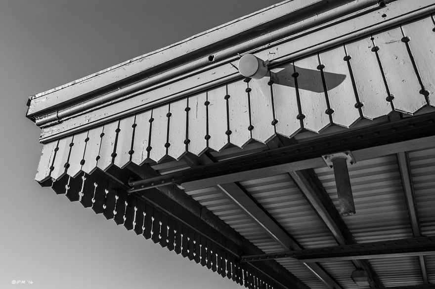 Tannoy speaker on wooden roof with ornamental detailing, Didcot Station Oxfordshire UK. Monochrome Landscape. © P. Maton 2014 eyeteeth.net