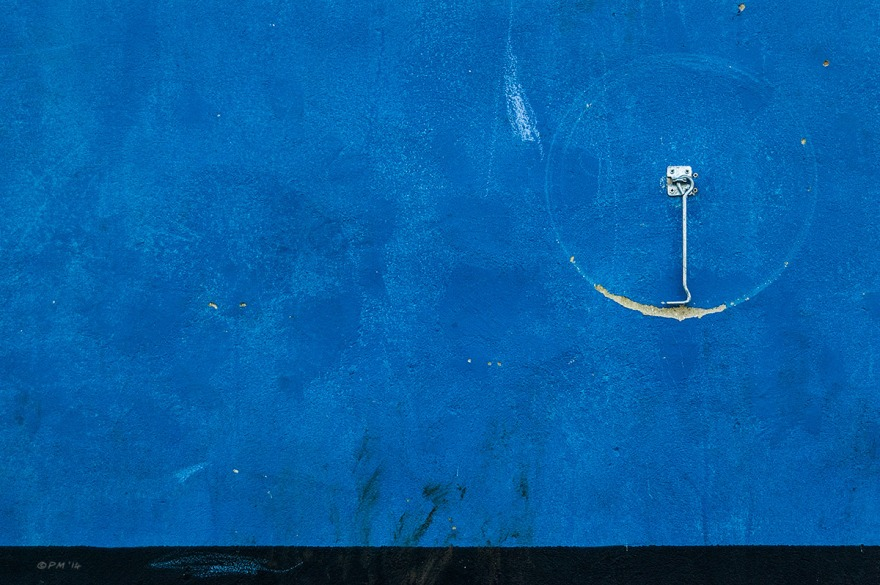 Blue rendered wall with hooked door retainer hanging from eyelet. Abstract. Colour Landscape. © P. Maton 2014 eyeteeth.net