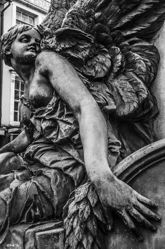 Bronze of bare breasted angel with dove on her shoulder. War Memorial, Lewes East Sussex. Monochrome Portrait.  © P. Maton 2015 eyeteeth.net