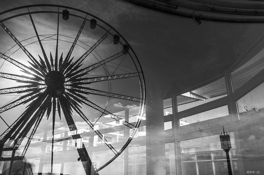The Brighton Eye big wheel reflected in window of Deco seafront building. Marine Parade Brighton UK. Monochrome Landscape. © P. Maton 2015 eyeteeth.net