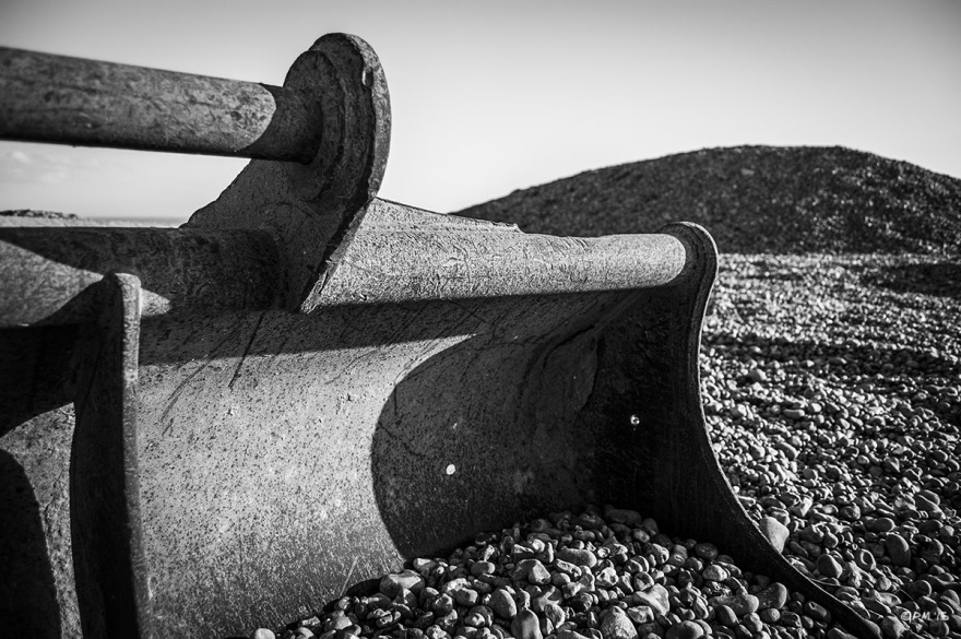Steel bucket from digger on shingle beach with mound. Hove Beach Sussex UK. Monochrome Landscape. © P. Maton 2015 eyelet.net
