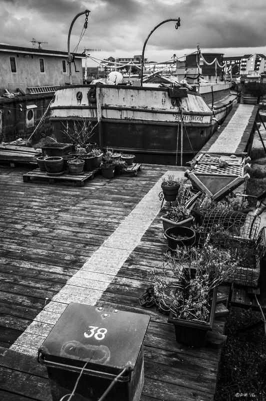 Houseboat named Ethelwood moored on jetty with white matting and box number 38.  River Adur Shoreham Harbour UK. Monochrome Portrait. © P. Maton 2015 eyeteeth.net