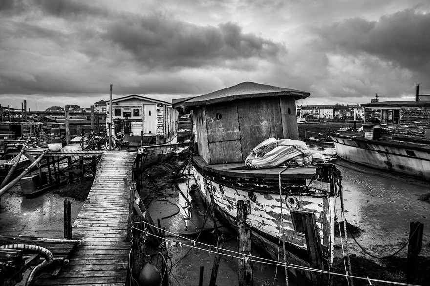 Jetty and houseboats on Shoreham harbour at the mouth of the River Adur West Sussex UK. Black and white maritime photography. P. Maton 2015 eyeteeth.net