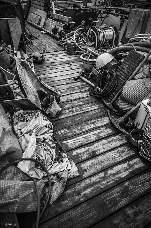 Cluttered jetty with path showing wet floor boards. River Adur Shoreham Harbour UK. Monochrome Landscape. © P. Maton 2015 eyeteeth.net