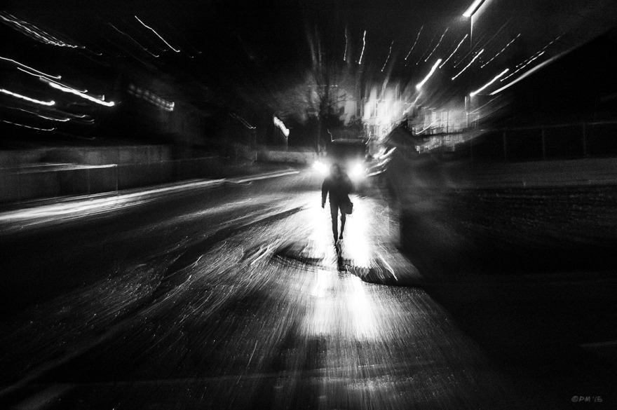 Man on street corner in rain at night with head lights behind him, zoom effect camera shake. Chatham Place Brighton UK. Monochrome Landscape. © P. Maton 2015 eyeteeth.net