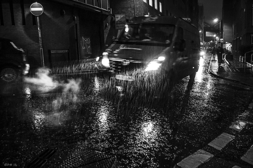Van in rain at night time on wet road with reflected head lights. Fredrick Place Brighton UK. Monochrome Landscape. © P. Maton 2015 eyeteeth.net
