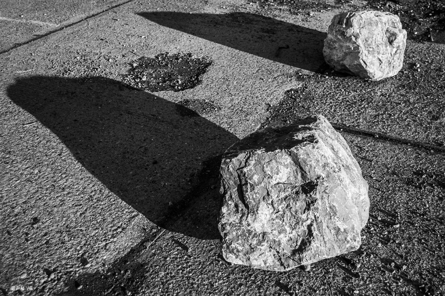 Two rocks casting shadows on concrete. Shoreham Sussex UK. Monochrome Landscape. © P. Maton 2015 eyeteeth.net