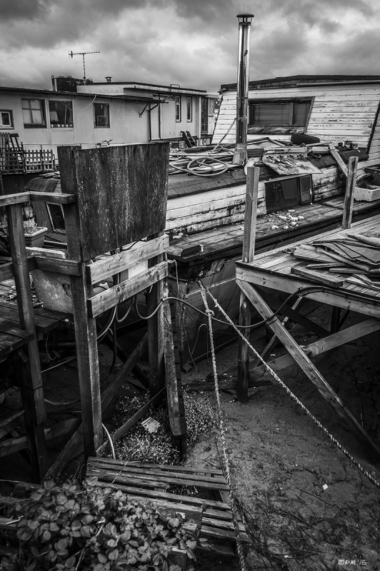 Jetty with ropes, houseboats and view down to mud at low tide.  River Adur Shoreham Harbour UK. Monochrome Landscape. © P. Maton 2015 eyeteeth.net